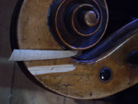 Repairs to cello scroll (click for larger image)